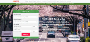 Screenshot of NICONICO Rent a Car top page. Shows a car reservation box and a sakura blossom background.