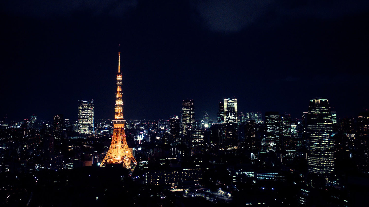 Aerial night view of Tokyo with an illuminated Tokyo Tower.